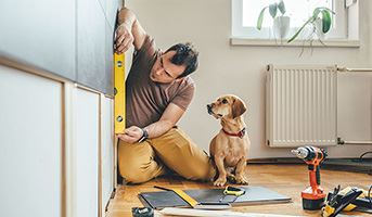 Man conducting home maintenance