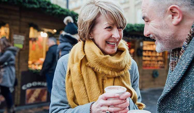 mature couple outdoors drinking coffee