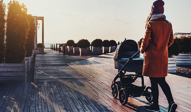 Mom Walking On Dock With Stroller