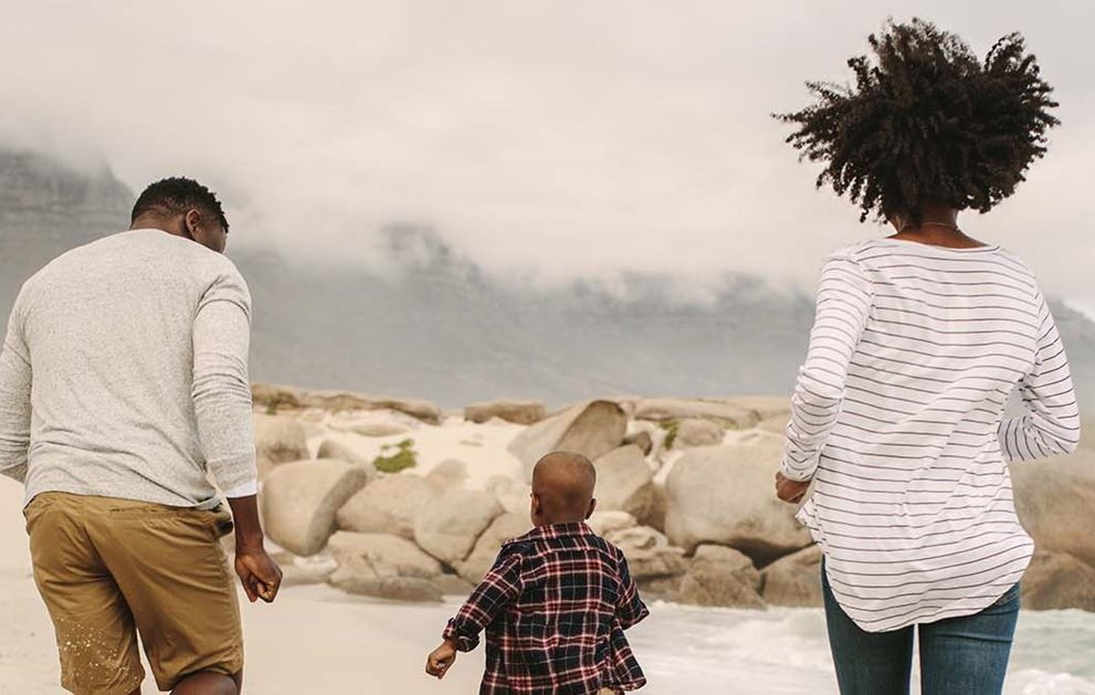 African American Family Of Three On Beach